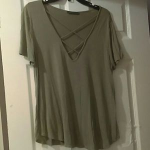 Olive green top with criss cross design on chest